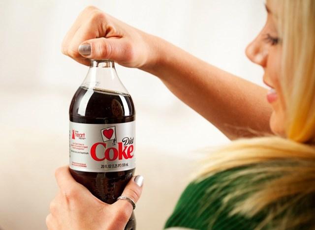 Woman drinking diet coke