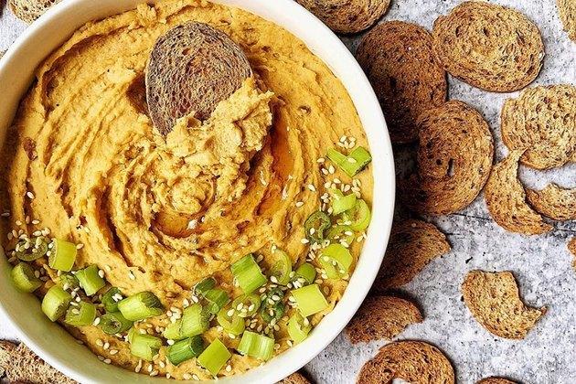 Mediterranean snacks of healthy crackers with hummus