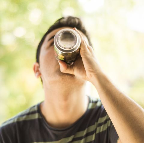 a young man drinking a can mens health diet soda weight gain loss