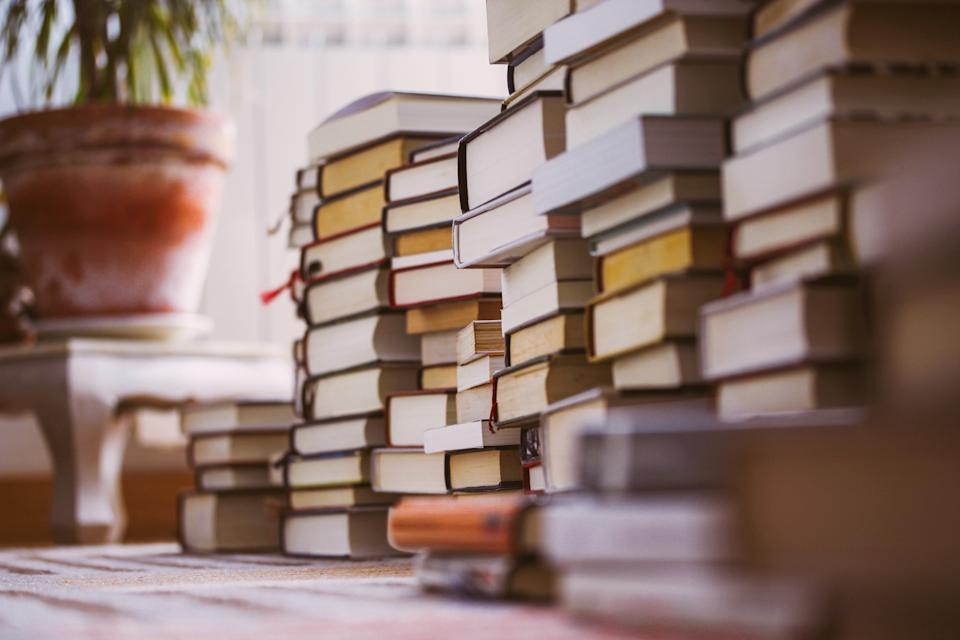 The predictability of your favourite book can help ease anxiety (Image via Getty Images).