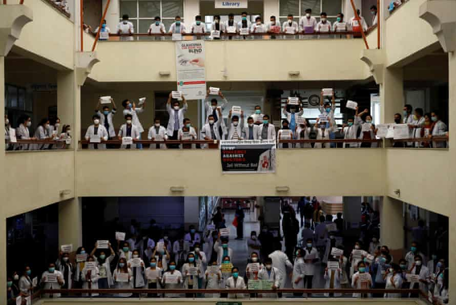 Doctors holding placards protest against assaults on doctors at Nepal Medical College and Teaching Hospital during the lockdown, in Kathmandu on 31 May.